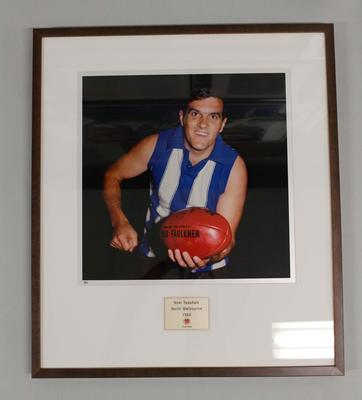 Framed reproduction photograph of  Noel Teasdale, North Melbourne F.C. from Scanlens 1966 Flag Series football cards
