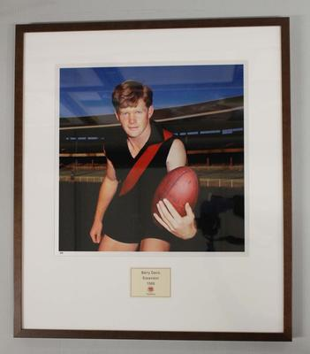 Framed reproduction photograph of Barry Davis, Essendon  F.C. from Scanlens 1966 Flag Series football cards