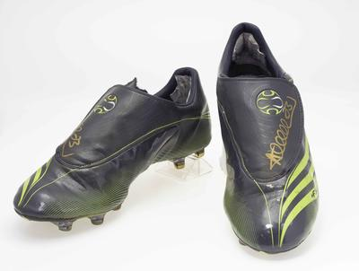 Autographed football boots worn by Andrew McLeod, 2007