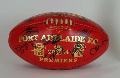 Signed football commemorating Port Adelaide's AFL Premiership, 2004