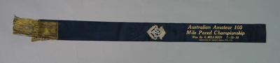 Sash with silver brooch attached, awarded to Ernie Milliken, Australian Amateur 100 Mile Paced Championship