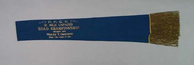 Sash, blue, satin; awarded to Tom Gascoyne - PPCC 25 Mile Unpaced Road Championship Season 1935