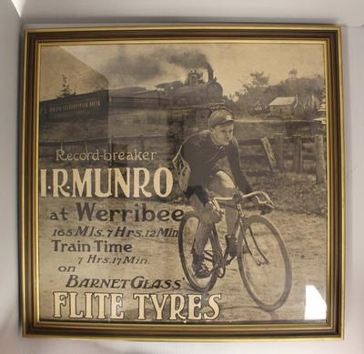 Elite Tyres promotional image produced in recognition of Iddo 'Snowy' Munro's record-breaking 'train time', c. 1909