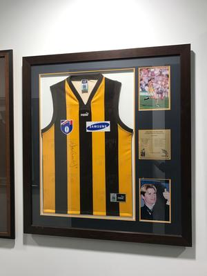 Framed and signed Shane Crawford Hawthorn AFL guernsey with photographs.