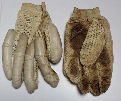 A pair of Frank Bryan Ltd. right-handed leather batting gloves, date unknown.