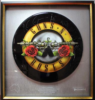 Framed and signed Guns n Roses drum skin