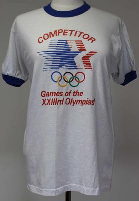 T-shirt issued by the Games Organising Committee to competitors at the 1984 Los Angeles Olympic Games, worn by Margot Foster.