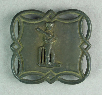Metal cast belt buckle featuring cricketer with bat c.1850