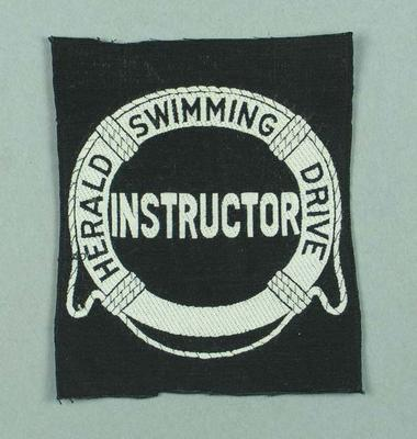 Cloth badge, produced for Herald Swimming Drive Instructor