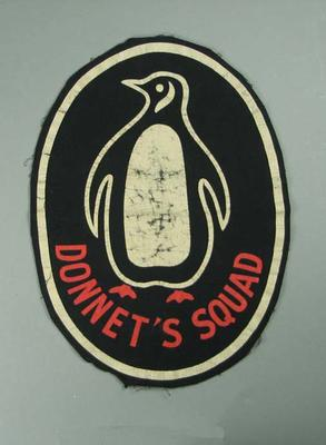 Oval  badge used by Tom Donnett, Australian Olympic Diving Coach, 1958