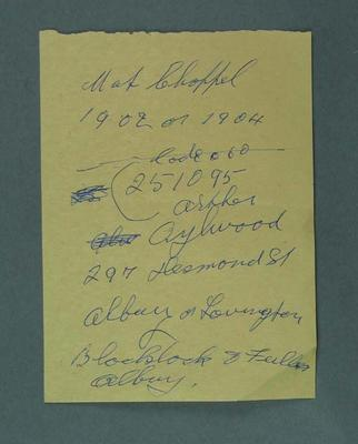 Page of orange note paper with name, address and dates. Written by Rupert Bates
