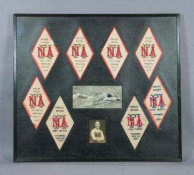Framed badges awarded by FINA to Frank Beaurepaire, 1910-1921