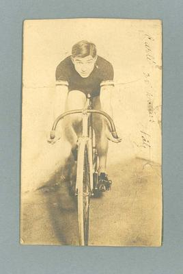Black and white postcard of cyclist