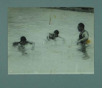 Photograph of Frank Beaurepaire teaching two boys how to swim