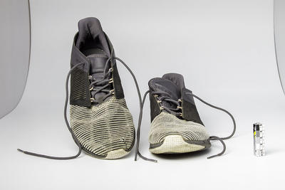 Pair of Reebok shoes with one split, worn by Nevanka Woolley
