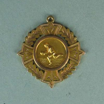 Gold Medallion inscribed George Haines, The Sporting Globe Football Plebiscite 1922; Trophies and awards; M3077