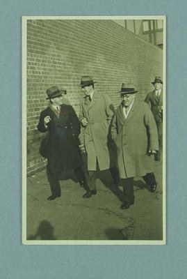 Photograph of Frank Beaurepaire walking with two other men