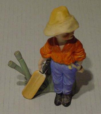 Ceramic figurine of a boy cricketer
