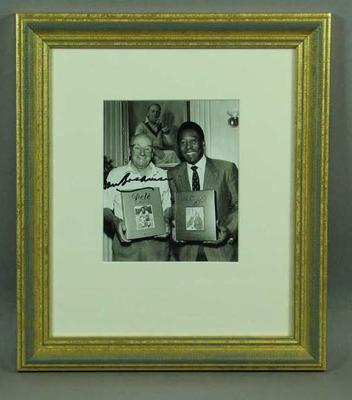 Photograph  of Don Bradman and Pele - photograph autographed by Bradman