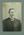 Formal studio portrait of a man in a suit