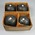Set of four lawn bowls, used by James McGregor Gillespie c1908