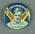 Badge, depicts Robert Berry c1950-51