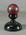 Red cricket ball with black stand, inscribed 'To Bill O'Reilly', Test Ball South Africa, Melbourne 1932