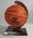 Basketball on stand signed by members of the North Melbourne Giants, 1994 NBL Champions.