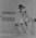 Copy negative depicting female cricketer, c1988
