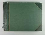 Green hardcover scrapbook with cuttings relating to Bob Spears