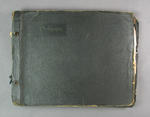 Black hardcover scrapbook with cuttings relating to Bob Spears