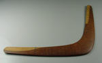 Boomerang signed by West Indies cricket team presented to Les Comino by Berkeley Gaskin, team manager.