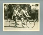 Black and white photograph of  Hubert Opperman and Ernie Milliken on a tandem bicycle