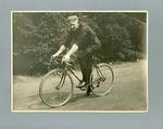 Black and white photograph of Ernie Milliken on his B.S.A. bicycle in England 1935
