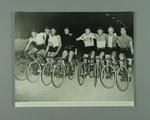 Black and white photographic copy showing Eight Australian Champions, one of whom is Eric Gibaud,  in Interstate Challenge Race, SA