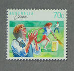 Postage stamp, image of children playing cricket