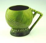 Mug, shaped like a cricket ball