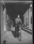 Photograph of Dot Edney with bicycle, c1939