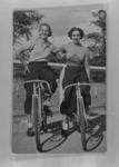 Copy negative of Dot Edney and another female cyclists with bicycles, c1930s
