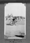 Copy negative of photograph in photo album, depicts cyclist Charlie Jenkins 1936