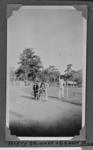 Copy negative of photograph in photo album, depicts cyclists c1930s