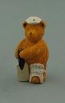 Miniature figure of a bear, with white cap, bat and cricket pad
