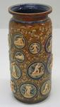 Royal Doulton vase designed by George Tinworth, featuring cricketing figures