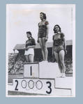 Photograph of women's discus athletes on victory dais, 1948 Olympic Games