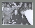 Photograph of Shirley Strickland signing autographs, International Friendly Sports Meeting of Youth 1955