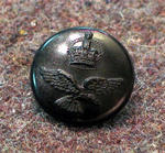 Button from RAAF uniform, worn during WWII occupation of MCG