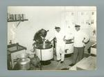 Photograph of two naval cooks in a kitchen, 1936 Olympic Games