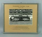 Framed black and white photograph of the Melbourne Football Club Premiers 1964.