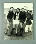 Black and white photograph of Brian Dixon and Ron Barassi  in football clothing