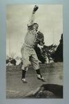 Black and white photograph of Victorian baseballer Brian Harvey achieving a double put-out  in training 1961